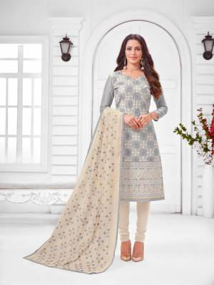 Grab This Designer Straight Suit For Your Semi-Casual Wear In Grey Color Paired With Off-White Colored Bottom and Dupatta. Its Top and Dupatta Are Modal Silk Based Paired With Cotton Bottom.