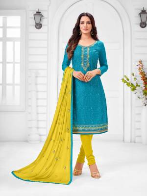 Here Is A Pretty Designer Straight Suit In Blue Color Paired With Contrasting Yellow Colored Bottom and Dupatta. Its Top Is Modal Silk Based Paired With Cotton Bottom and Chiffon Dupatta. All Its Fabrics Are Light Weight And Easy To Carry All Day Long.