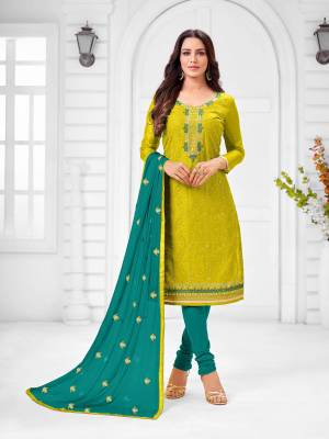 Here Is A Pretty Designer Straight Suit In Pear Green Color Paired With Contrasting Blue Colored Bottom and Dupatta. Its Top Is Modal Silk Based Paired With Cotton Bottom and Chiffon Dupatta. All Its Fabrics Are Light Weight And Easy To Carry All Day Long.