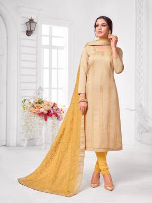 Grab This Designer Straight Suit For Your Semi-Casual Wear In Beige Color Paired With Yellow Colored Bottom and Dupatta. Its Top and Dupatta Are Modal Silk Based Paired With Cotton Bottom.
