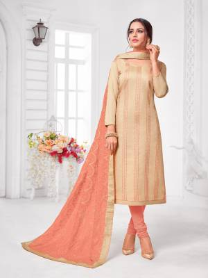 Grab This Designer Straight Suit For Your Semi-Casual Wear In Beige Color Paired With Peach Colored Bottom and Dupatta. Its Top and Dupatta Are Modal Silk Based Paired With Cotton Bottom.