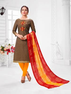 Here Is A Pretty Designer Straight Suit In Brown Color Paired With Contrasting Musturd Yellow And Red Colored Bottom and Dupatta. Its Top Is Modal Silk Based Paired With Cotton Bottom and Chiffon Dupatta. All Its Fabrics Are Light Weight And Easy To Carry All Day Long.