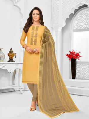Simple And Elegant Looking Designer Straight Suit Is Here In Occur Yellow Color Paired With Sand Grey Colored bottom And Dupatta. Its Top Is Fabricated On Tussar Art Silk Paired With Cotton Bottom and Chiffon Dupatta.