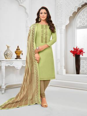 Simple And Elegant Looking Designer Straight Suit Is Here In Pastel Green Color Paired With Sand Grey Colored bottom And Dupatta. Its Top Is Fabricated On Tussar Art Silk Paired With Cotton Bottom and Chiffon Dupatta.