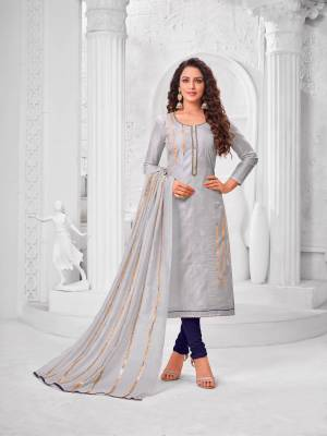 Grab This Designer Straight Suit For Your Semi-Casual Wear In Light Grey Color Paired With Navy Blue Colored Bottom And Light Grey Colored Dupatta. Its Top Is Fabricated On Modal Silk Paired With Cotton Bottom And Dupatta.