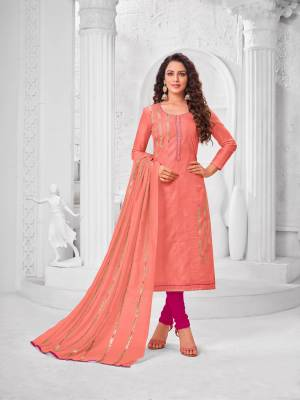 Grab This Designer Straight Suit For Your Semi-Casual Wear In Peach Color Paired With Magenta Pink Colored Bottom And Peach Colored Dupatta. Its Top Is Fabricated On Modal Silk Paired With Cotton Bottom And Dupatta.
