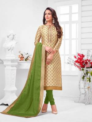 Simple And Elegant Looking Designer Straight Suit Is Here In Beige Color Paired With Parrot Green Colored bottom And Dupatta. Its Top Is Fabricated On Chanderi Silk Paired With Cotton Bottom and Dupatta.