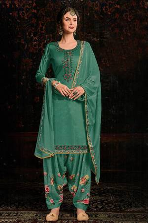 Grab This Beautiful Designer Suit For This Festive Season In Sea Green color. Its Embroidered Top Is Fabricated On Cotton Satin Paired With Floral Printed Cotton Bottom And Chiffon Fabricated Dupatta.