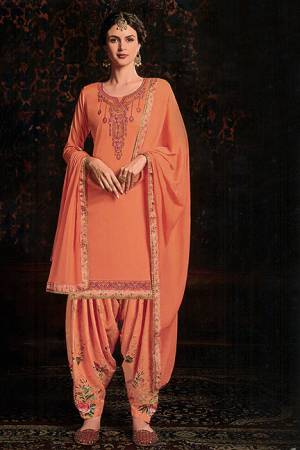 Add Designer Patiala Suit To Your Wardrobe In Orange Color. Its Top IS Fabricated On Cotton Satin Paired With Cotton Bottom And Chiffon Fabricated Dupatta. It Is Beautified With Floral Printed Bottom And Embroidered Top.