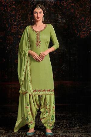 Grab This Beautiful Designer Suit For This Festive Season In Light Green color. Its Embroidered Top Is Fabricated On Cotton Satin Paired With Floral Printed Cotton Bottom And Chiffon Fabricated Dupatta.