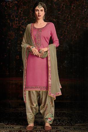 Add Designer Patiala Suit To Your Wardrobe In Pink Colored Top Paired With Beige Colored Bottom And Dupatta. Its Top IS Fabricated On Cotton Satin Paired With Cotton Bottom And Chiffon Fabricated Dupatta. It Is Beautified With Floral Printed Bottom And Embroidered Top.