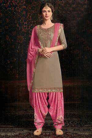 Add Designer Patiala Suit To Your Wardrobe In Sand Grey Colored Top Paired With Pink Colored bottom and Dupatta. Its Top IS Fabricated On Cotton Satin Paired With Cotton Bottom And Chiffon Fabricated Dupatta. It Is Beautified With Floral Printed Bottom And Embroidered Top.