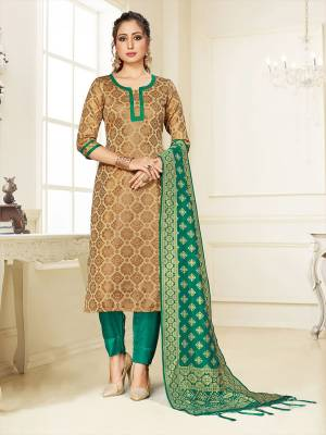 Grab This Pretty Designer Straight Suit In Beige Color Paired With Sea Green Colored Bottom And Dupatta. Its Top, Bottom And Dupatta Are Fabricated On Cotton Silk Beautified With Weave.