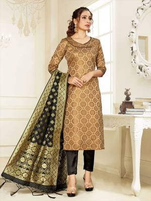 Grab This Pretty Designer Straight Suit In Beige Color Paired With Black Colored Bottom And Dupatta. Its Top, Bottom And Dupatta Are Fabricated On Cotton Silk Beautified With Weave.