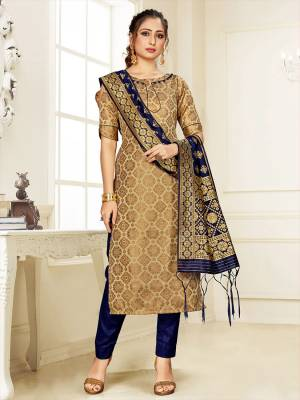 Grab This Pretty Designer Straight Suit In Beige Color Paired With Navy Blue Colored Bottom And Dupatta. Its Top, Bottom And Dupatta Are Fabricated On Cotton Silk Beautified With Weave.