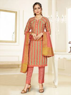 Simple And Elegant Looking Designer Straight Suit In Dark Peach Color. Its Top, Bottom And Dupatta Are Fabricated On Cotton Beautified With Prints. Its Fabric Ensures Superb Comfort All Day Long.