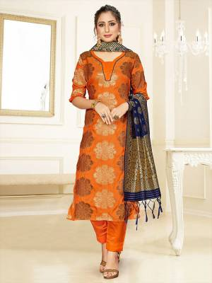 Celebrate This Festive Season Wearing this Designer Straight Suit In Orange Color Paired With Navy Blue Colored Dupatta. Its Top, Bottom And Dupatta Are Fabricated Banarasi Art Silk Beautified With Weave. Buy This  Suit Now.
