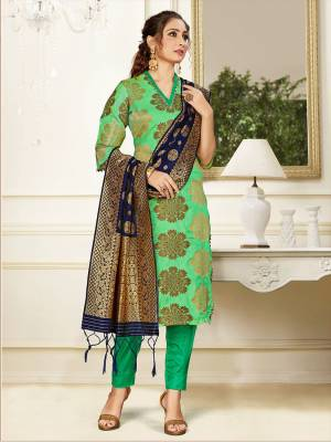 Celebrate This Festive Season Wearing this Designer Straight Suit In Light Green Color Paired With Navy Blue Colored Dupatta. Its Top, Bottom And Dupatta Are Fabricated Banarasi Art Silk Beautified With Weave. Buy This  Suit Now.