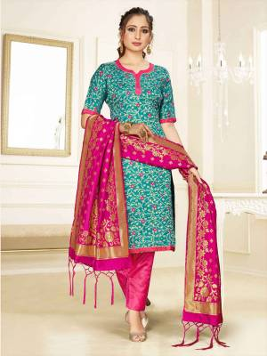 Celebrate This Festive Season Wearing this Designer Straight Suit In Blue And Rani Pink Color Paired With Rani Pink Colored Dupatta. Its Top, Bottom And Dupatta Are Fabricated Banarasi Art Silk Beautified With Weave. Buy This  Suit Now.