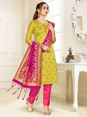 Celebrate This Festive Season Wearing this Designer Straight Suit In Pear Green  And Rani Pink Color Paired With Rani Pink Colored Dupatta. Its Top, Bottom And Dupatta Are Fabricated Banarasi Art Silk Beautified With Weave. Buy This  Suit Now.