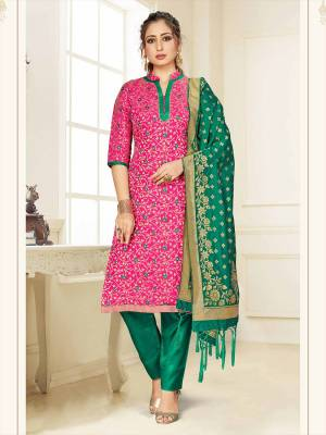 Celebrate This Festive Season Wearing this Designer Straight Suit In Rani Pink And Sea Green Color Paired With Sea Green Colored Dupatta. Its Top, Bottom And Dupatta Are Fabricated Banarasi Art Silk Beautified With Weave. Buy This  Suit Now.