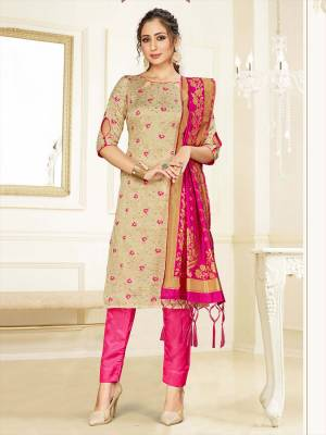 Celebrate This Festive Season Wearing this Designer Straight Suit In Beige And Rani Pink Color Paired With Rani Pink Colored Dupatta. Its Top, Bottom And Dupatta Are Fabricated Banarasi Art Silk Beautified With Weave. Buy This  Suit Now.