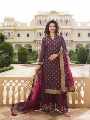 Here Is A Very Pretty Designer Straight Suit In Wine Color. Its Top And Dupatta Are Fabricated On Jacquard Silk Paired With Art Silk Fabricated Bottom. It Is Beautified With Weave And Embroidery. Also Its Rich Fabric And Color Will Definitely Earn You Lots Of Compliments From Onlookers.