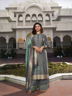 Flaunt Your Rich And Elegant Taste Wearing This Designer Straight Suit In Grey Color. This Pretty Top And Dupatta Are Fabricated On Jacquard Silk Paired With Art Silk Fabricated Bottom. Buy This Semi-Stitched Suit Now.