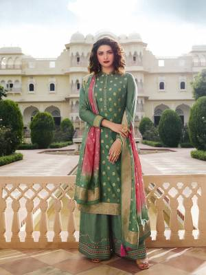 Here Is A Very Pretty Designer Straight Suit In Light Green Color. Its Top And Dupatta Are Fabricated On Jacquard Silk Paired With Art Silk Fabricated Bottom. It Is Beautified With Weave And Embroidery. Also Its Rich Fabric And Color Will Definitely Earn You Lots Of Compliments From Onlookers.