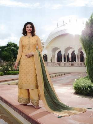 Here Is A Very Pretty Designer Straight Suit In Cream Color. Its Top And Dupatta Are Fabricated On Jacquard Silk Paired With Art Silk Fabricated Bottom. It Is Beautified With Weave And Embroidery. Also Its Rich Fabric And Color Will Definitely Earn You Lots Of Compliments From Onlookers.