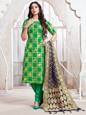 Celebrate This Festive Season In A Proper Traditional Look Wearing This Weaved Straight Suit In Green Color Paired with Navy Blue Colored Dupatta. This Pretty Suit Is Fabricated On Banarasi Silk Beautified With Weave.