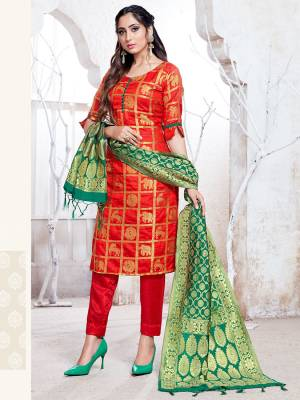 Here Is A Rich And Elegant Looking Silk Based Straight Suit In Red Color Paired With Green Colored Dupatta. Its Top, Bottom And Dupatta Are Fabricated On Banarasi Silk Beautified With Attractive Weave. Buy Now.