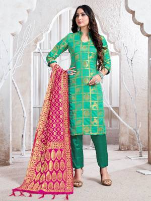 Celebrate This Festive Season In A Proper Traditional Look Wearing This Weaved Straight Suit In Sea Green Color Paired with Rani Pink Colored Dupatta. This Pretty Suit Is Fabricated On Banarasi Silk Beautified With Weave.