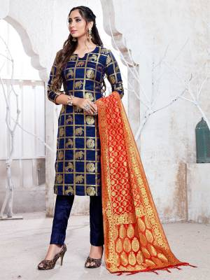 Here Is A Rich And Elegant Looking Silk Based Straight Suit In Navy Blue Color Paired With Red Colored Dupatta. Its Top, Bottom And Dupatta Are Fabricated On Banarasi Silk Beautified With Attractive Weave. Buy Now.