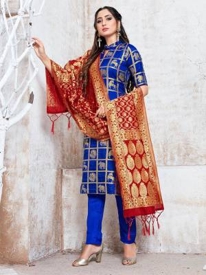 Celebrate This Festive Season In A Proper Traditional Look Wearing This Weaved Straight Suit In Royal Blue Color Paired with Maroon Colored Dupatta. This Pretty Suit Is Fabricated On Banarasi Silk Beautified With Weave.