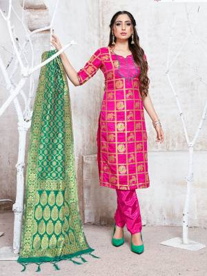 Here Is A Rich And Elegant Looking Silk Based Straight Suit In Rani Pink Color Paired With Sea Green Colored Dupatta. Its Top, Bottom And Dupatta Are Fabricated On Banarasi Silk Beautified With Attractive Weave. Buy Now.