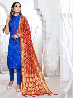 Celebrate This Festive Season In A Proper Traditional Look Wearing This Weaved Straight Suit In Royal Blue Color Paired with Red Colored Dupatta. This Pretty Suit Is Fabricated On Banarasi Silk Beautified With Weave.