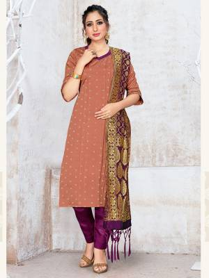 Here Is A Rich And Elegant Looking Silk Based Straight Suit In Beige Color Paired With Purple Colored Bottom And Dupatta. Its Top, Bottom And Dupatta Are Fabricated On Banarasi Silk Beautified With Attractive Weave. Buy Now.