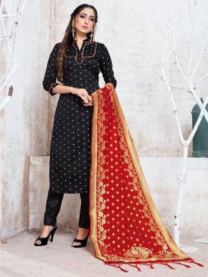 Celebrate This Festive Season In A Proper Traditional Look Wearing This Weaved Straight Suit In Black Color Paired with Red Colored Dupatta. This Pretty Suit Is Fabricated On Banarasi Silk Beautified With Weave.