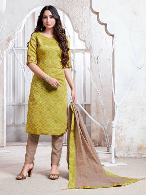 Flaunt Your Rich And Elegant Taste Wearing This Pretty Light Green And Beige Colored Straight Suit. Its Top, Bottom And Dupatta Are Fabricated On Cotton Silk Which Gives A Rich Look To Your Personality.