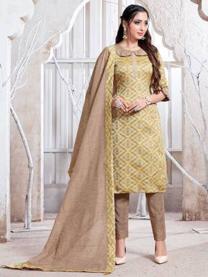 Add This Pretty Simple Straight Suit To Your Wardrobe In Musturd & Beige Color. This Suit Is Fabricated On Cotton Silk Which Is Durable, Soft Towards Skin And Easy To Carry All Day Long.