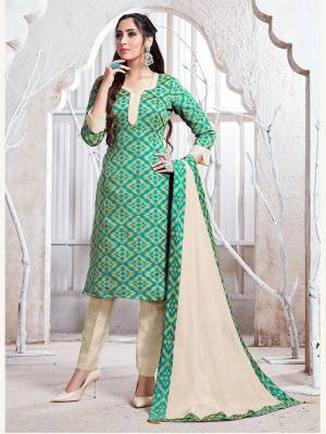 Flaunt Your Rich And Elegant Taste Wearing This Pretty Sea Green And Cream Colored Straight Suit. Its Top, Bottom And Dupatta Are Fabricated On Cotton Silk Which Gives A Rich Look To Your Personality.