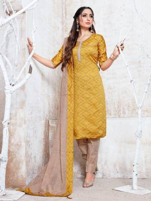 Flaunt Your Rich And Elegant Taste Wearing This Pretty Musturd Yellow And Beige Colored Straight Suit. Its Top, Bottom And Dupatta Are Fabricated On Cotton Silk Which Gives A Rich Look To Your Personality.