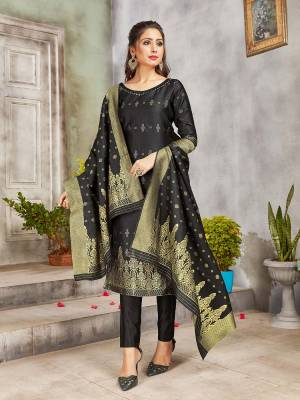 Celebrate This Festive Season Wearing this Designer Straight Suit In Black Color. Its Top, Bottom And Dupatta Are Fabricated Banarasi Art Silk Beautified With Weave. Buy This  Suit Now.