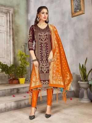 Grab This Pretty Designer Straight Suit In Wine and Orange Color. Its Top, Bottom And Dupatta Are Fabricated On Banarasi Art Silk Beautified With Weave. Its Fabric and Color Gives A Rich Look To Your Perosnality.