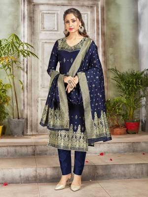 Celebrate This Festive Season Wearing this Designer Straight Suit In Navy Blue Color. Its Top, Bottom And Dupatta Are Fabricated Banarasi Art Silk Beautified With Weave. Buy This  Suit Now.