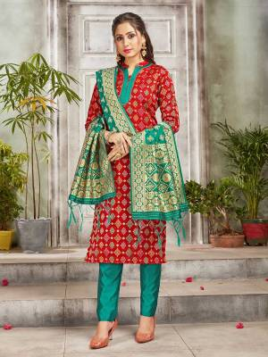 Celebrate This Festive Season Wearing this Designer Straight Suit In Red And Sea Green Color. Its Top, Bottom And Dupatta Are Fabricated Banarasi Art Silk Beautified With Weave. Buy This  Suit Now.