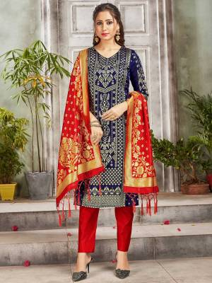 Celebrate This Festive Season Wearing this Designer Straight Suit In Navy Blue and Red Color. Its Top, Bottom And Dupatta Are Fabricated Banarasi Art Silk Beautified With Weave. Buy This  Suit Now.