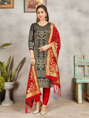 Celebrate This Festive Season Wearing this Designer Straight Suit In Black And Red Color. Its Top, Bottom And Dupatta Are Fabricated Banarasi Art Silk Beautified With Weave. Buy This  Suit Now.