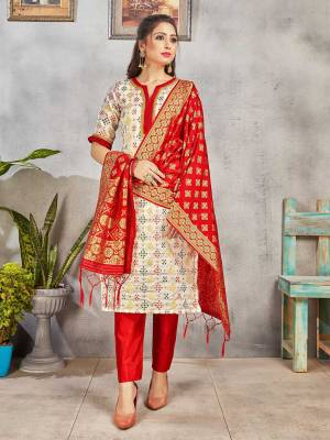 Grab This Pretty Designer Straight Suit In Off-White And Red Color. Its Top, Bottom And Dupatta Are Fabricated On Banarasi Art Silk Beautified With Weave. Its Fabric and Color Gives A Rich Look To Your Perosnality.